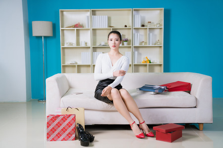 young fashion woman at home with nice presents Reklamní fotografie