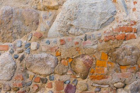 The stonework is old, the background of the stones