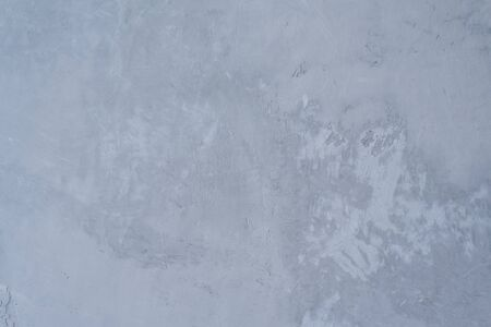 Gray background of plaster wall or putty on wall, copy space for text