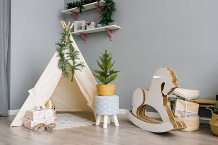 Children's room with toys, wigwam, horse. christmas decor