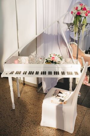 Decorative piano with flowers in wedding or exhibition decor