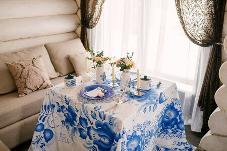 Festive table with Gzhel tablecloth and decor in Russian style at a wedding or party