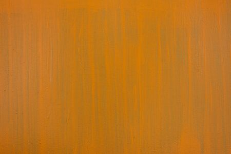 Orange-green paint strokes on a flat surface. Copy space