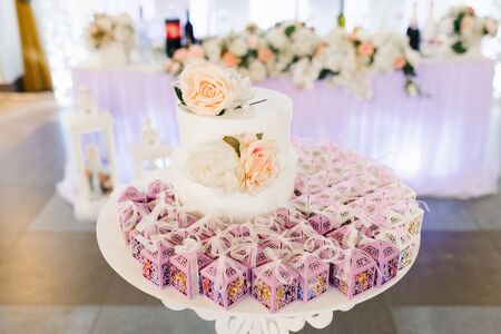 Wedding bonbonnieres, lilac openwork paper boxes at the wedding Banquet