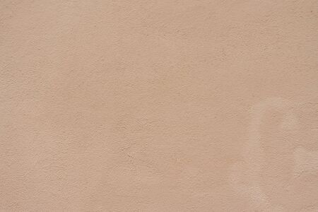 Cream background or texture. Decorative plaster on the wall. Sand color beige