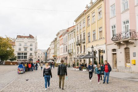 Lviv, Ukraine. October 2019. Tourists and residents of the city on the Market square of the old city