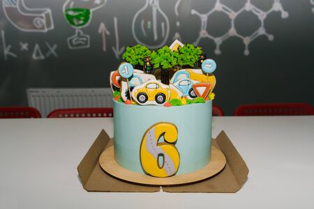 Childrens birthday cake for a 6 year old boy with cars and transport
