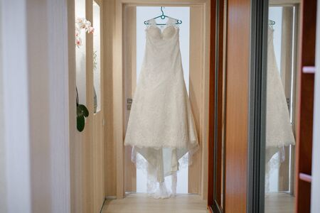 Beautiful vist bride dress in the house. Wedding morning and event preparation Stock fotó