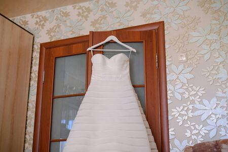 Beautiful vist bride dress in the house. Wedding morning and event preparation
