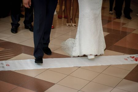 The feet of the bride and groom step on the handbrake.