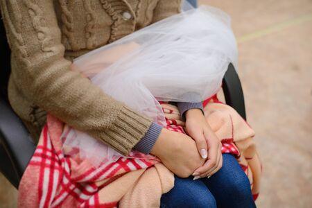 The girl bride is preparing for the wedding.She holds a veil in her lap. Reklamní fotografie