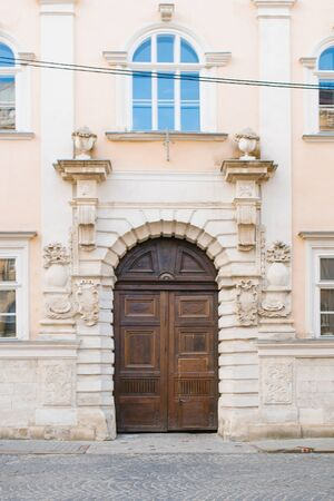 Lviv, Ukraine. October 2019. Beautiful wooden doors in an old historical building