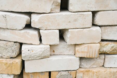 bricks of different sizes and textures, background of stacked bricks