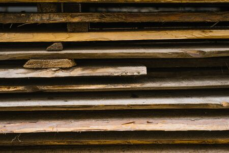old wooden planks are stacked one on top of the other. wooden background for design Reklamní fotografie