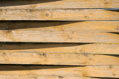 Wooden boards with shadows on them. Textural striped background for copy space Reklamní fotografie