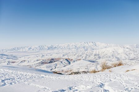Beautiful panoramic view of snow covered mountains. The best view from the Beldersay cable-way 版權商用圖片