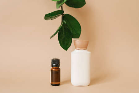 Natural organic cosmetics with plant extracts. Two bottles of face and body care products. 写真素材
