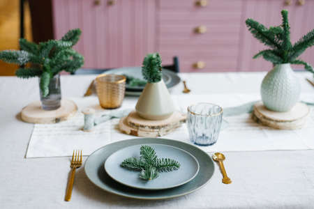 Table setting with festive decorations. Preparing for Christmas or new year's dinner