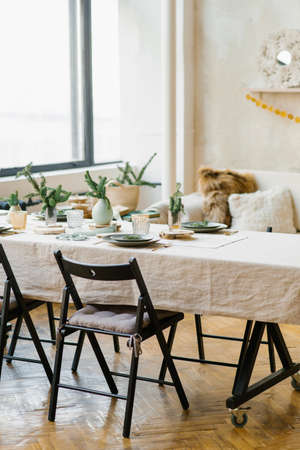 Scandinavian comfort in the dining room on Christmas eve. Festive table setting