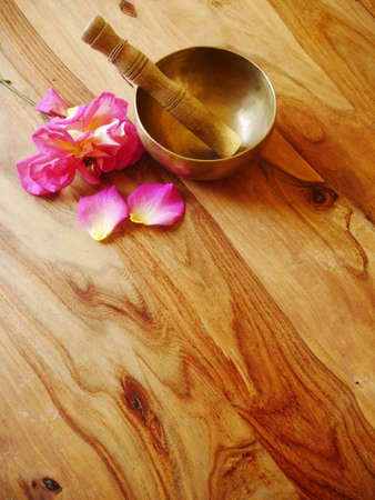 Singing metal bowl to relax and receive healing vibrations, the rose adds freshness to the meditation session