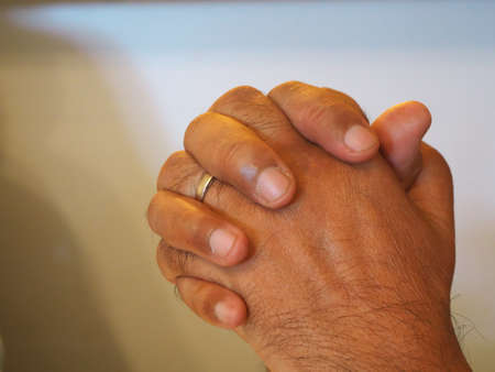 Close-up of the hands of an African man praying