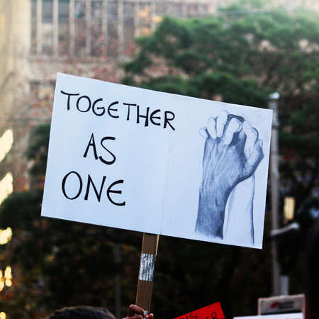 A sign reading 'together as one'. Black Lives Matter Protest March. Protesting Aboriginal deaths in custody and the death of George Floyd. During a worldwide pandemicofcoronavirus disease 2019 (Covid 19) Sydney, NSW / Australia - June 6 2020: