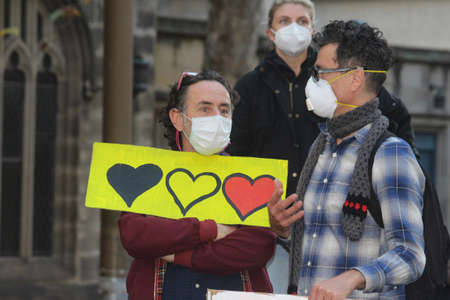 Two men holding a protest sign with three hearts in aboriginal colours. Black Lives Matter Protest March. Protesting Aboriginal deaths in custody and the death of George Floyd. During a worldwide pandemicofcoronavirus disease 2019 (Covid 19) Sydney, N Redakční