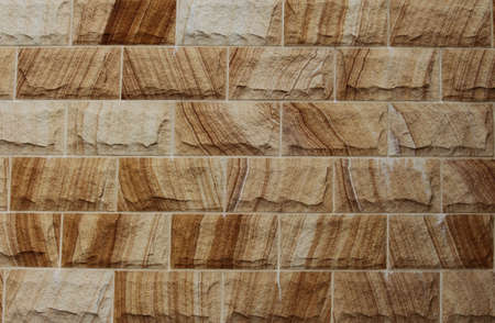 Sandstone block wall with grain. Texture background