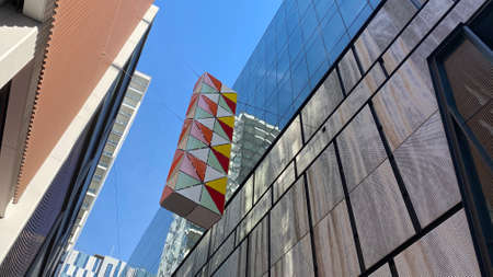 Sydney, NSW / Australia - August 3 2019: Decorative architectural element suspended between the buildings of Steam Mill Lane, Darling Square