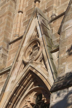 Detail on a church,  some of the sandstone requiring restoration. Hunter Baillie Memorial Presbyterian Church a heritage listed church. The church is an example of Gothic Revival architecture