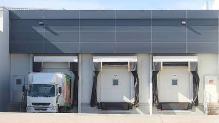 Three refrigerated truck loading docks of a modern food manufacturing facility. Western Sydney Australia