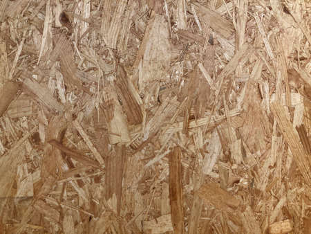 Construction board or oriented strand board (OSB) engineered wood, showing compressed layers of wood strands. Plywood