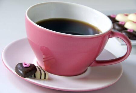 Coffee with chocolate hearts                    Stock Photo