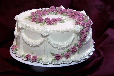 royal background: Cake with pink roses                    Stock Photo