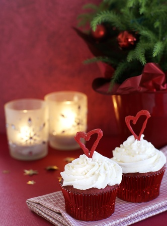 Red velvet cupcakes with vanilla frosting decorated for the Christmas holiday         Stock Photo