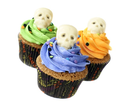 Pumpkin spice cupcakes decorated with skulls made of white chocolate
