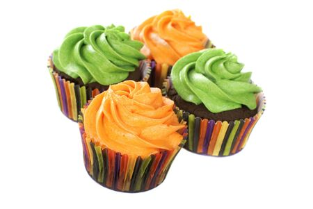 Chocolate cupcakes with vanilla frosting colored in bright colors.