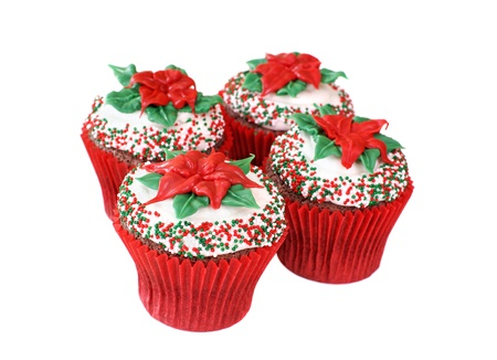 Cupcakes decorated with a Poinsettia made of colored white chocolate                  photo