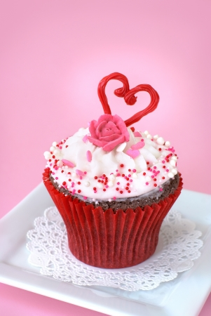 Chocolate cupcake with vanilla icing decorated with love                   photo