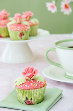 Wedding cupcakes with cup of coffee                 photo