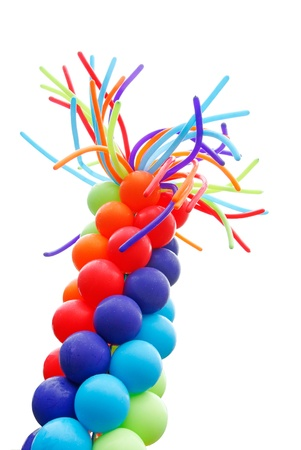 Red, blue, and green balloons on white background