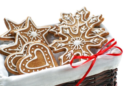 Gingerbread cookies decorated with royal icing arranged in a basket