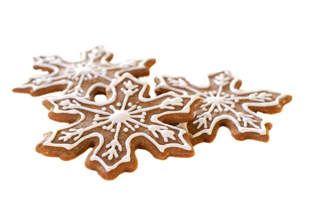 Gingerbread snowflake cookies decorated with white icing          Stock Photo