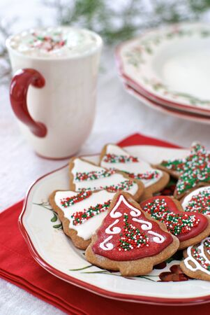 Gingerbread cookies decorated for Christmas with icing and sprinkles.                  Stock Photo