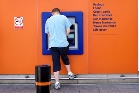 cashpoint: man using cash machine, ATM, cashpoint, bank machine