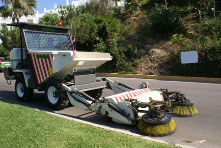 sweeper: street sweeper. street cleaner