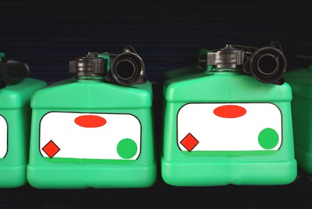 fuelling pump: Spare Petrol Fuel Container Bottles Stock Photo