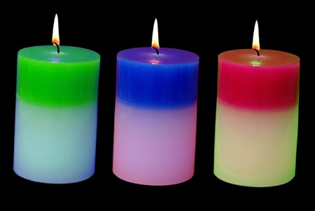 lit: lit candles. color changing candles Stock Photo