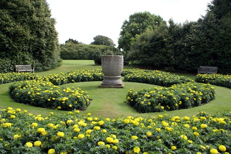 flower beds: flower beds and ornamental urn in a sunken garden