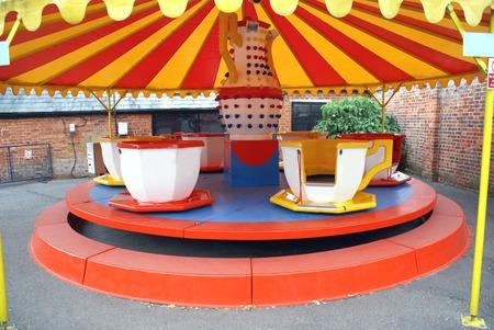 carnival ride: tea cup ride. carnival ride. Children amusement